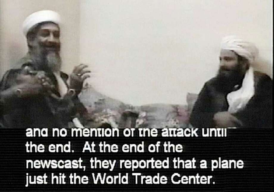 This file frame grab from a videotape released and translated by the U.S. Department of Defense Dec. 13, 2001, in Washington, shows Al-Qaida leader Osama bin Laden. The man at right is unidentified. A person familiar with developments on Sunday, May 1, 2011 says bin Laden is dead and the U.S. has the body. Photo: AP