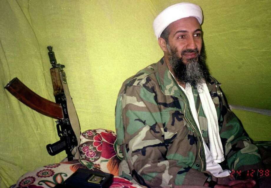 In this Dec. 24, 1998, file photo, Muslim militant and Al Quida leader Osama Bin Laden speaks to a selected group of reporters in mountains of Helmand province in southern Afghanistan. A person familiar with developments said Sunday, May 1, 2011 that bin Laden is dead and the U.S. has the body. Photo: AP