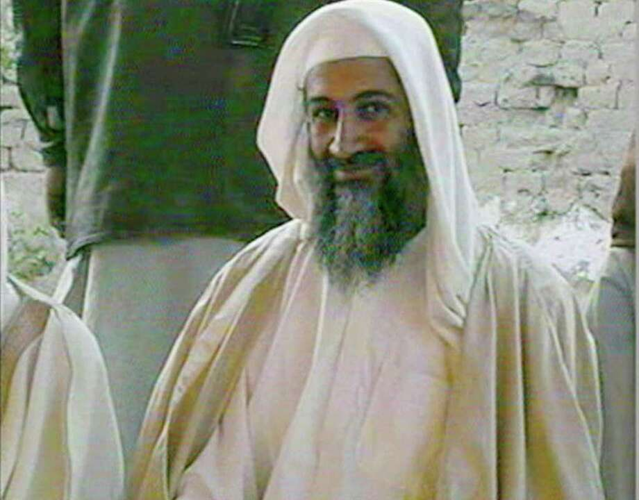 In this file television image broadcast on Qatar's Al-Jazeera TV, is said to show Osama bin Laden, at the wedding of his son in January 2001. A person familiar with developments said Sunday, May 1, 2011 that bin Laden is dead and the U.S. has the body. Photo: AP
