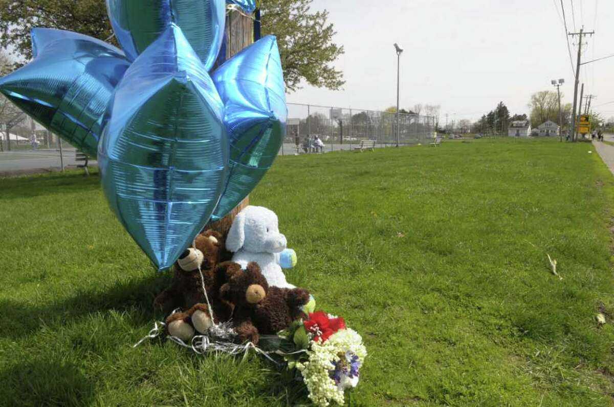 A memorial, seen here on Sunday afternoon, May 1, 2011 in Albany, has been set up on the edge of Hoffman Park for Tyler Rhodes of Albany who was stabbed Saturday near the area and later died of his injuries. (Paul Buckowski / Times Union)