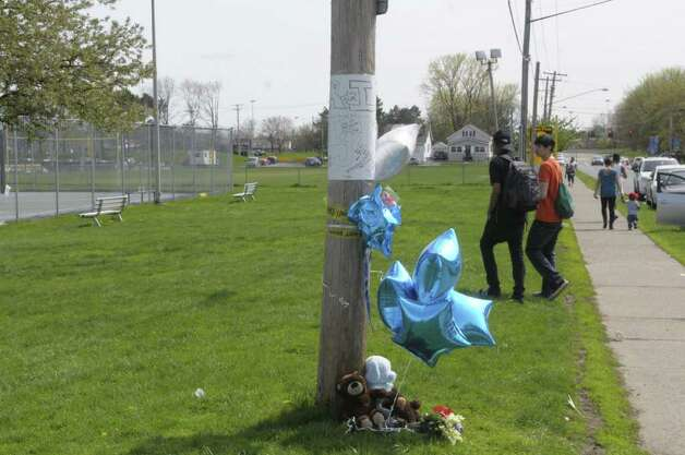 A memorial, seen here on Sunday afternoon, May 1, 2011 in Albany,  has been set up on the edge of Hoffman Park for Tyler Rhodes of Albany who was stabbed Saturday near the area and later died of his injuries.  (Paul Buckowski / Times Union) Photo: Paul Buckowski