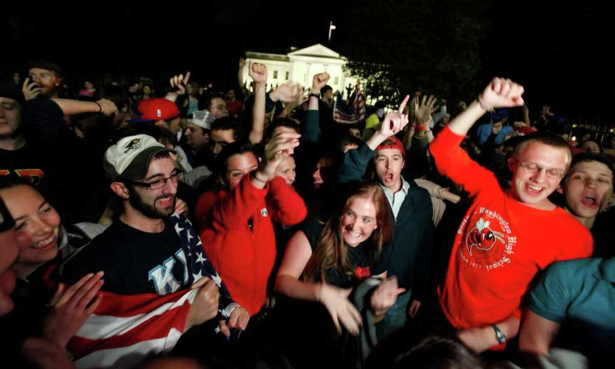 A crowd outside the White House in Washington, cheers Sunday, May 1, 2011, upon hearing the news that terrorist leader Osama bin Laden is dead. (AP Photo/Manuel Balce Ceneta)
