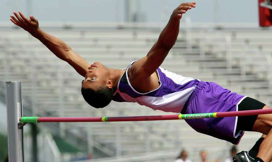 San Marcos junior Allex Austin, son of U.S. high jump record-holder Charles Austin, prepares for regionals after a national-best jump in April. Photo: Tom Reel/Express-News / © 2011 San Antonio Express-News