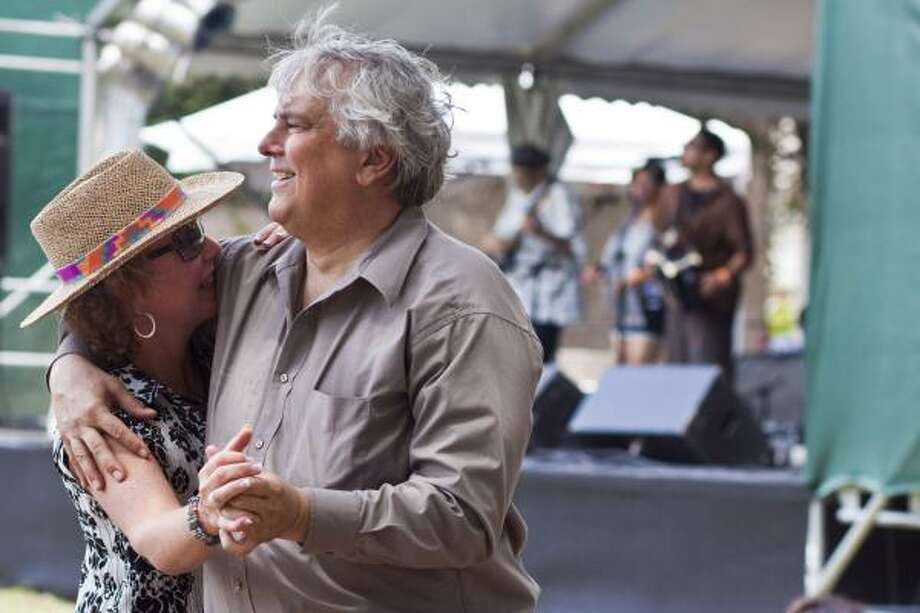 Robert Schaadt and Carol Skewes dance to zydeco music Sunday at the Houston International Festival downtown. Photo: Eric Kayne, Chronicle