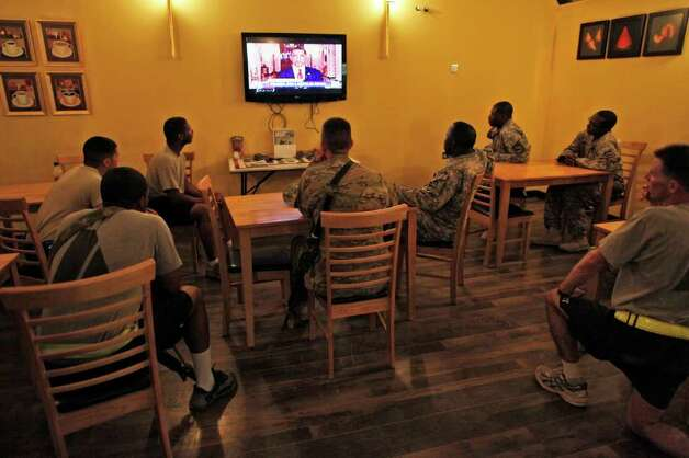 United States military troops watch the announcement by President Barack Obama that Osama bin Laden had been killed, at the USO at Kandahar Airfield, southern Afghanistan, Monday, May 2, 2011. Photo: AP