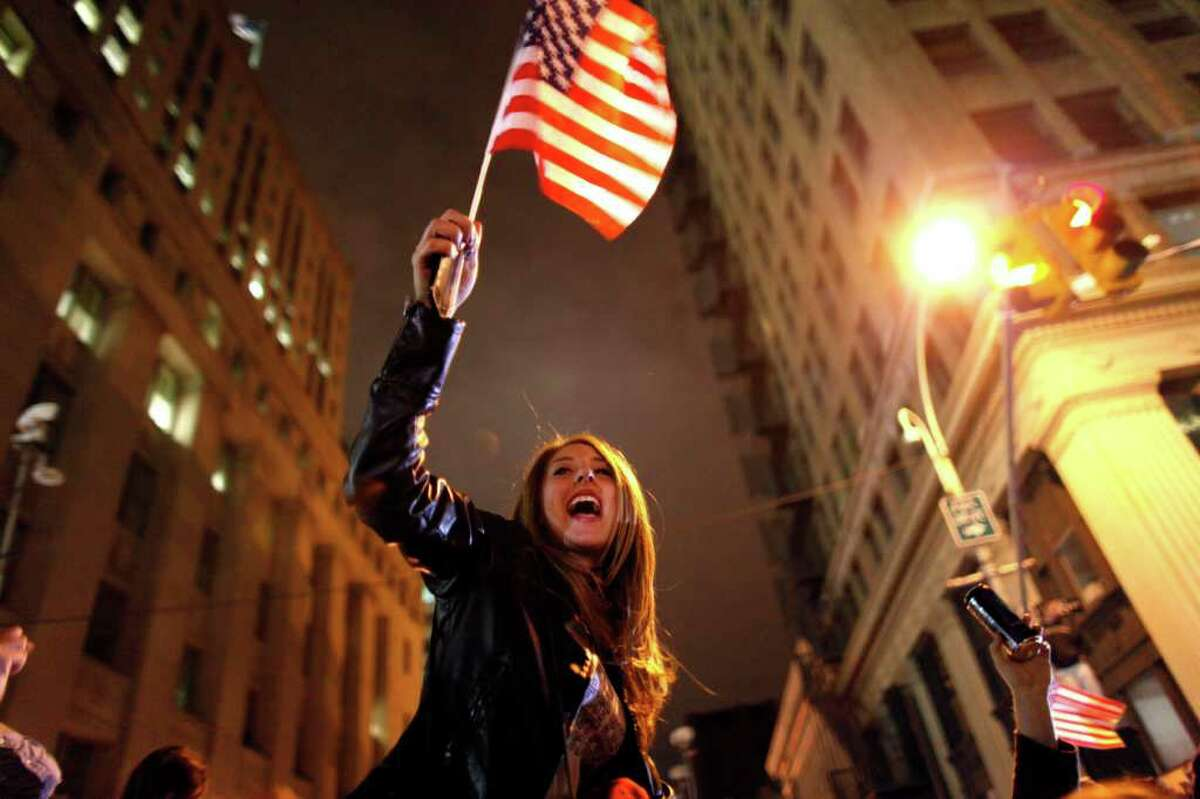A large, jubilant crowd reacts to the news of Osama Bin Laden's death at the corner of Church and Vesey Streets, adjacent to ground zero, during the early morning hours of Tuesday, May 2, 2011 in New York.