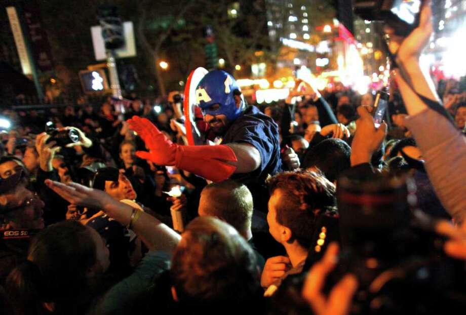 A large, jubilant crowd reacts to the news of Osama Bin Laden's death at the corner of Church and Vesey Streets, adjacent to ground zero, during the early morning hours of Tuesday, May 2, 2011 in New York. Photo: AP