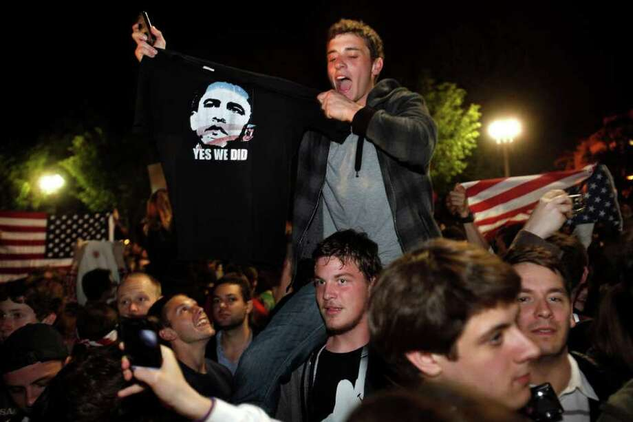 A man holds up a shirt of President Barack Obama as crowds celebrate on Pennsylvania Avenue in front of the White House in Washington, early Monday, May 2, 2011, after President Barack Obama announced that Osama bin Laden had been killed. Photo: AP