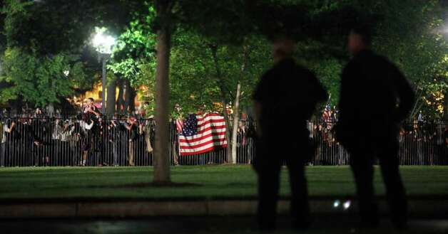 Secret Service Police watch the crowd celebrating outside the White House in Washington early Monday, May 2, 2011, after President Barack Obama announced the death of Osama bin Laden. Photo: AP