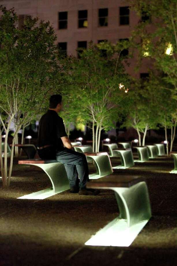 A man sits on a bench a the Pentagon Memorial early Monday, May 2, 2011, at the Pentagon in Washington, after President Barack Obama announced the death of Osama Bin Laden. Photo: AP