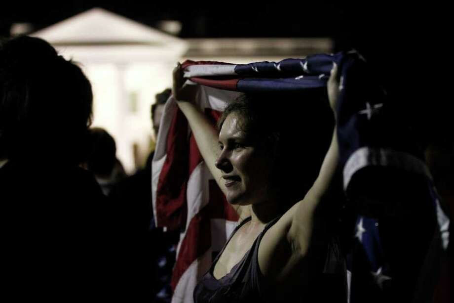 Allyson Childress of Falls Church, Va., joins the crowds celebrating on Pennsylvania Avenue in front of the White House in Washington, early Monday, May 2, 2011, after President Barack Obama announced that Osama bin Laden had been killed. Photo: AP