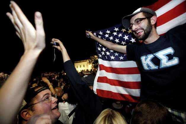 "Don Reade, 20, of Long Island, N.Y., cheers with hundreds of people, many fellow students from George Washington University, as they gather by the White House in Washington early Monday, May 2, 2011, to cheer the United States after President Barack Obama announced that Osama bin Laden had been killed. ""I'm a New Yorker so this is a really big deal to me,"" said Reade. Photo: AP"