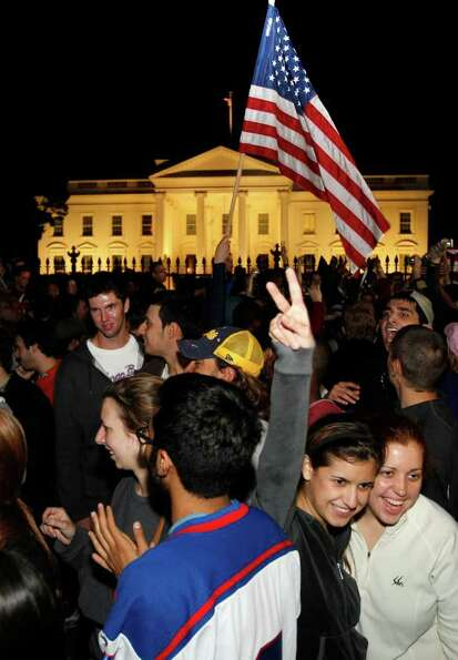 Crowds celebrate on Pennsylvania Avenue in front of the White House in Washington, early Monday, May