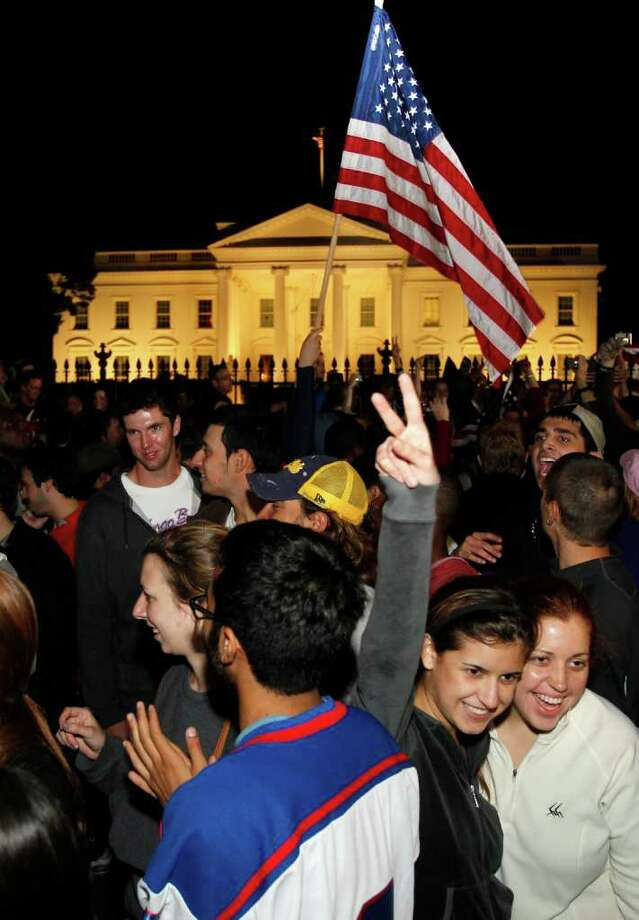 Crowds celebrate on Pennsylvania Avenue in front of the White House in Washington, early Monday, May 2, 2011, after President Barack Obama announced that Osama bin Laden had been killed. Photo: AP