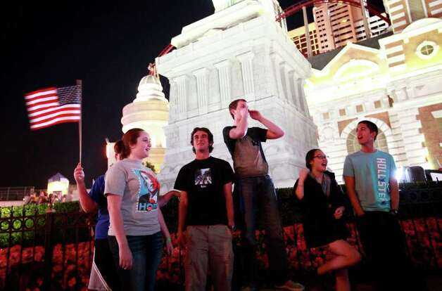 Las Vegas locals gather outside of New York New York Hotel and Casino in reaction to news of Osama bin Laden's death, Sunday, May 1, 2011 in Las Vegas. Photo: AP