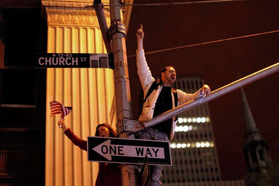A large, jubilant crowd reacts to the news of Osama bin Laden's death at the corner of Church and Ve