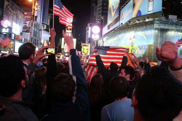 A crowd gathered in New York's Times Square reacts to the news of Osama Bin Laden's death early Monday morning May 2, 2011. Bin Laden, the glowering mastermind behind the Sept. 11, 2001, terror attacks that murdered thousands of Americans, was killed in an operation led by the United States, President Barack Obama said Sunday. Photo: AP