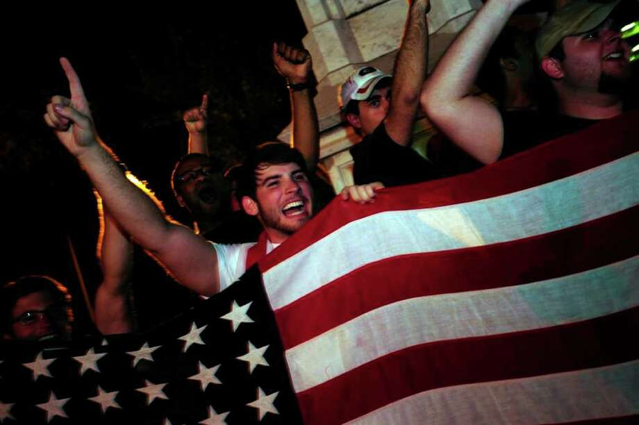 University of Georgia students wave flags as they celebrate the death of Osama bin Laden in front of a Civil War Memorial on the morning of Monday May 2, 2011 in Athens, Ga. (AP Photo/Athens Banner-Herald, David Manning) MANDATORY CREDIT Photo: AP
