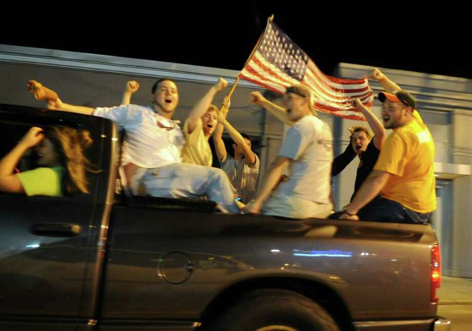 University of Tennessee students cheer as they ride down Cumberland Avenue in Knoxville, Tenn., after President Obama's announcement  Sunday, May 1, 2011, that terror leader Osama bin Laden had been killed in Pakistan. Photo: AP