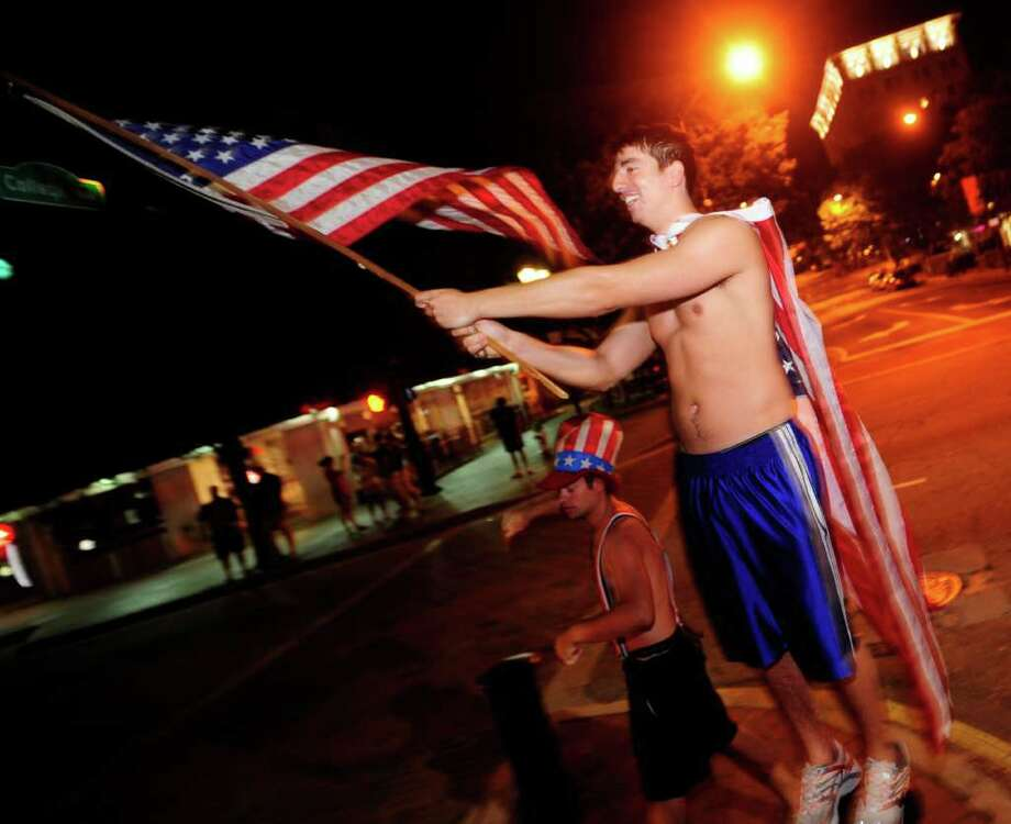 University of Georgia student Iain Turnbull waves a flag as he celebrates the death of Osama Bin Laden in front of a Civil War Memorial on the morning of Monday May 2, 2011 in Athens, Ga. President Barack Obama announced Sunday night, May 1, 2011, that Osama bin Laden was killed in an operation led by the United States. Photo: AP