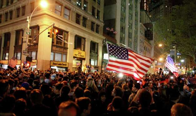 A large, jubilant crowd reacts to the news of Osama Bin Laden's death at the corner of Church and Vesey Streets, adjacent to ground zero, during the early morning hours of Tuesday, May 2, 2011 in New York. President Barack Obama announced Sunday night, May 1, 2011, that Osama bin Laden was killed in an operation led by the United States. Photo: AP