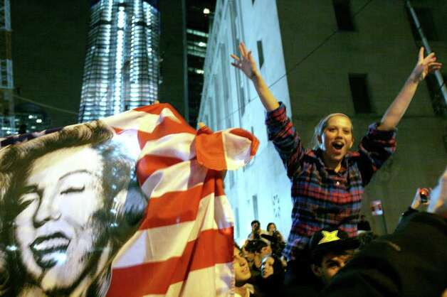 People celebrate at ground zero in New York Monday May. 2, 2011 after President Barack Obama announced Sunday night, May 1, 2011, that Osama bin Laden was killed in an operation led by the United States. Photo: AP