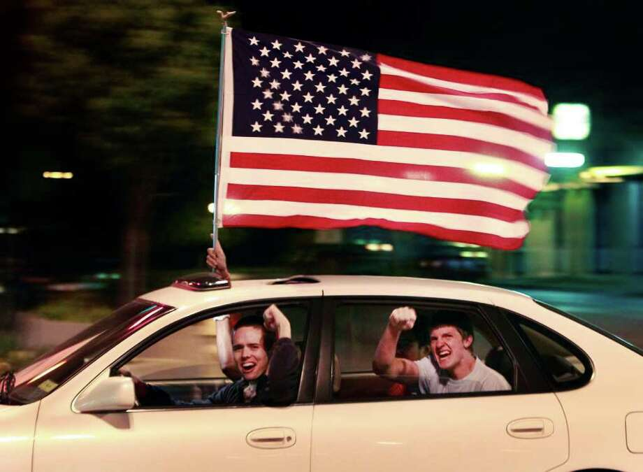 A driver and passengers celebrate the death of Osama bin Laden in the streets of Lawrence, Kan., Sunday, May 1, 2011. President Barack Obama announced Sunday night, May 1, 2011, that Osama bin Laden was killed in an operation led by the United States. Photo: AP