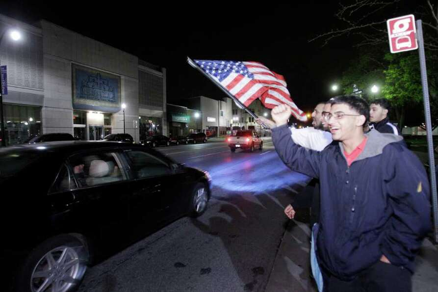 Arab Americans celebrate the news of the death of Osama Bin Laden in Dearborn, Mich., early Monday,