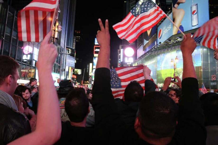 A crowd in New York's Times Square reacts to the news of Osama Bin Laden's death early Monday morning May 2, 2011. President Barack Obama announced Sunday night, May 1, 2011, that Osama bin Laden was killed in an operation led by the United States. Photo: AP