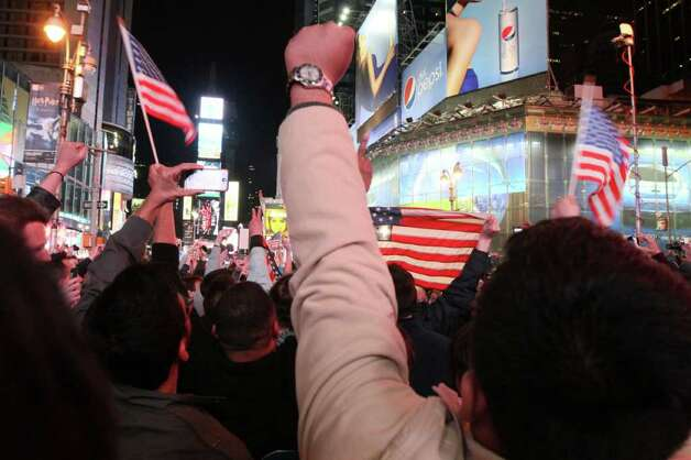 People in New York's Times Square react to the news of Osama Bin Laden's death early Monday morning May 2, 2011. President Barack Obama announced Sunday night, May 1, 2011, that Osama bin Laden was killed in an operation led by the United States. Photo: AP