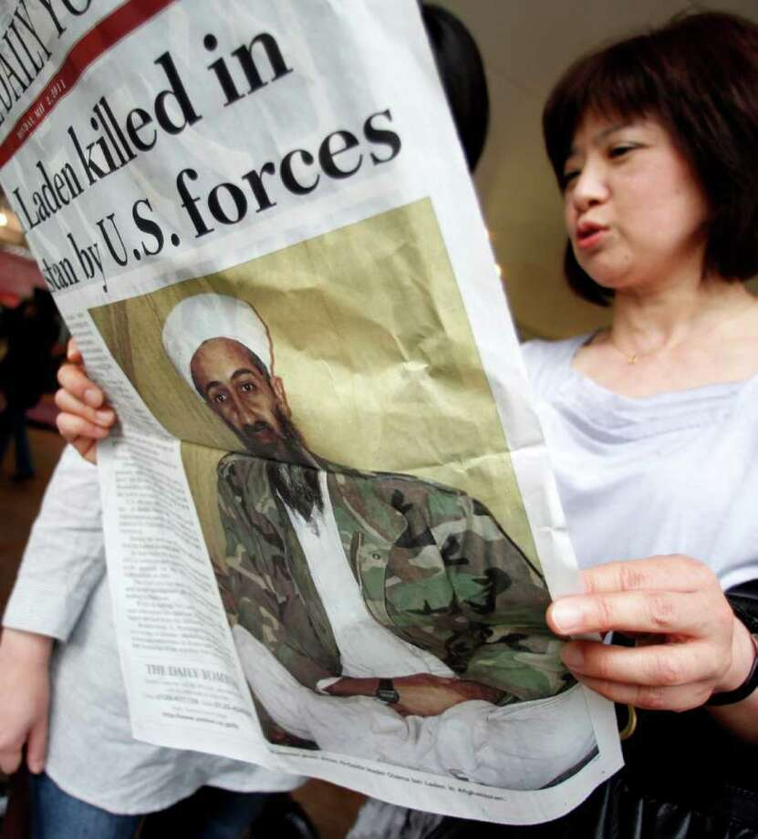 Women read an extra edition of a Japanese newspaper in Tokyo Monday, May 2, 2011, reporting Osama bin Laden, the glowering mastermind behind the Sept. 11, 2001, terror attacks was killed in an operation led by U.S. forces. Photo: AP