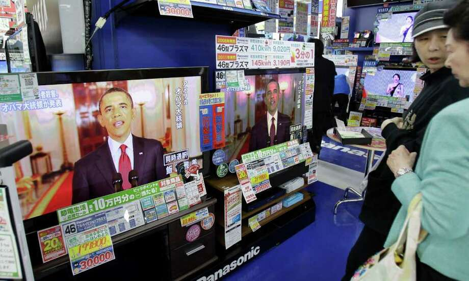 President Barack Obama, making a statement on the death of Osama bin Laden, is shown on TVs at an electronics retailer in Tokyo on Monday May 2, 2011. Obama said Osama bin Laden, the glowering mastermind behind the Sept. 11, 2001, terror attacks that killed thousands of Americans, was killed in an operation led by the United States. Photo: AP