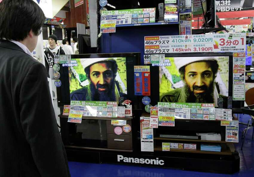 A Japanese watches TV on the death of Osama bin Laden, at an electronics retailer in Tokyo on Monday