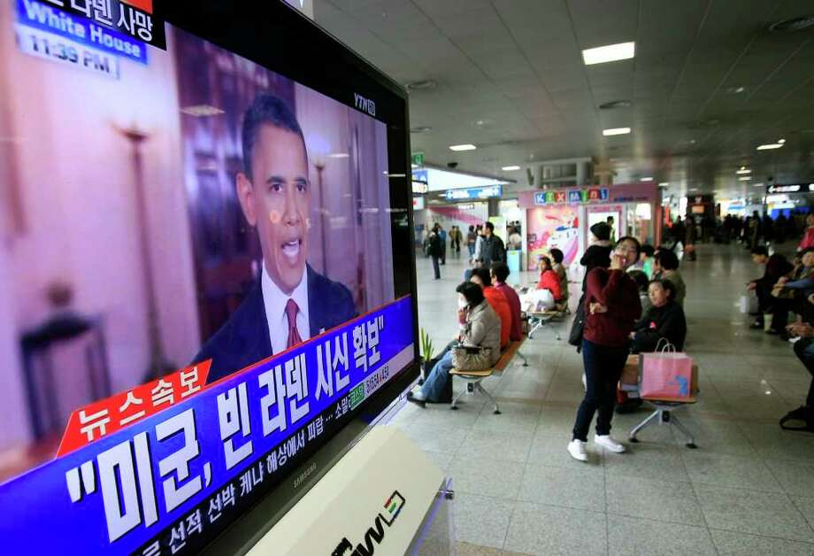 "People watch a live TV reporting of U.S. President Barack Obama's speech about Osama bin Laden, at Seoul train station in Seoul, South Korea, Monday, May 2, 2011. Bin Laden, the glowering mastermind behind the Sept. 11, 2001, terror attacks that murdered thousands of Americans, was killed in an operation led by the United States, Obama said Sunday. The Korean read "" U.S. soldiers, secure the body of bin Laden."" Photo: AP"