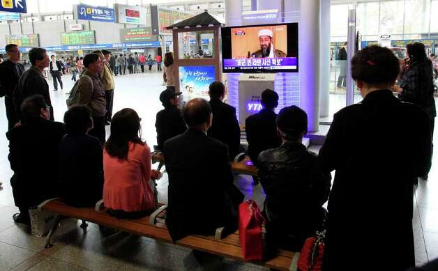 "South Koreans watch a TV broadcasting a report about Osama bin Laden, at Seoul train station in Seoul, South Korea, Monday, May 2, 2011. Osama bin Laden, the glowering mastermind behind the Sept. 11, 2001, terror attacks that murdered thousands of Americans, was killed in an operation led by the United States, President Barack Obama said Sunday. The Korean read "" U.S. soldiers secure the body of bin Laden."" Photo: AP"