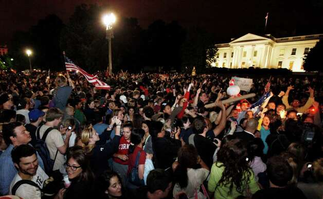 Crowds gathers outside the White House in Washington early Monday, May 2, 2011, to celebrate after President Barack Obama announced the death of Osama bin Laden. Photo: AP