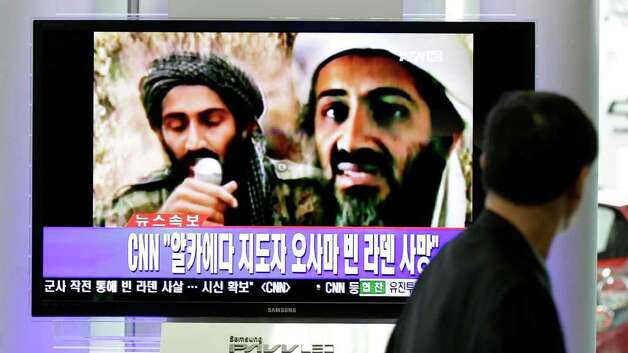 "A man watches a TV broadcast on the death of Osama bin Laden at Seoul train station in Seoul, South Korea, Monday, May 2, 2011. Osama bin Laden, the glowering mastermind behind the Sept. 11, 2001, terror attacks that killed thousands of Americans, was killed in an operation led by the United States, President Barack Obama said Sunday. The Korean read: ""Death, Osama bin Laden."" Photo: AP"
