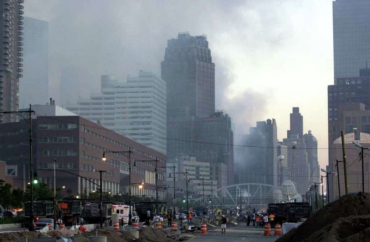 Smoke fills the air over two building that were damaged at the site of World Trade Center Bombing in New York Wednesday Sept. 12, 2001.