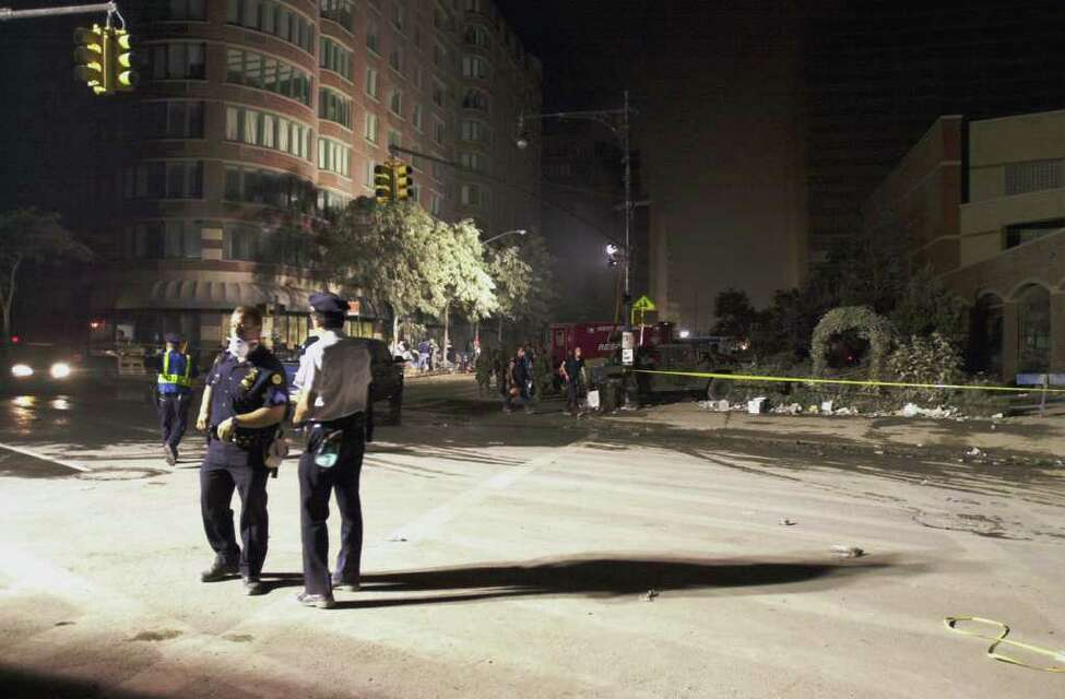 Police patrol ash covered streets near the site of World Trade Center Bombing in New York Wednesday Sept. 12, 2001.
