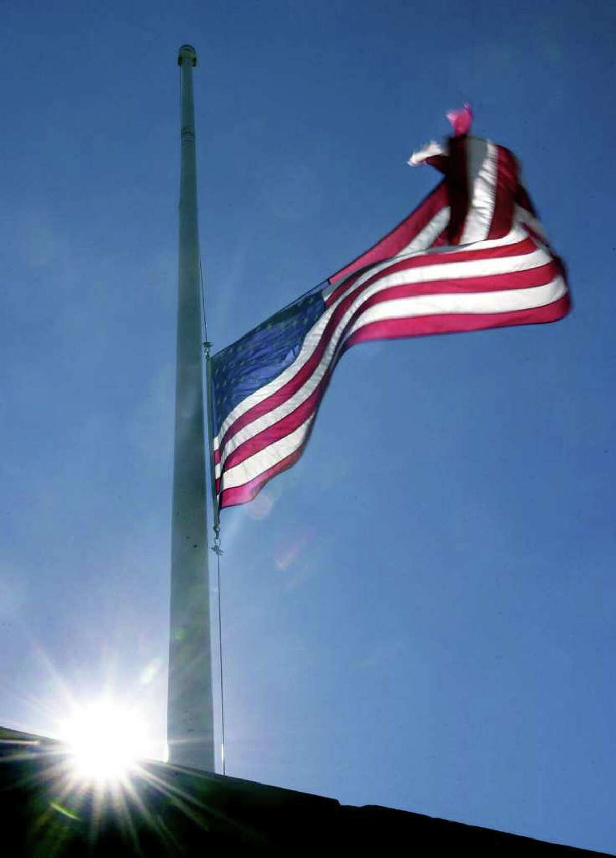 After the terrorist attack, a flag flies at half mast at Calf Pasture Beach. It was located at the Shea-Magrath Memorial and Wall of Remembrance.