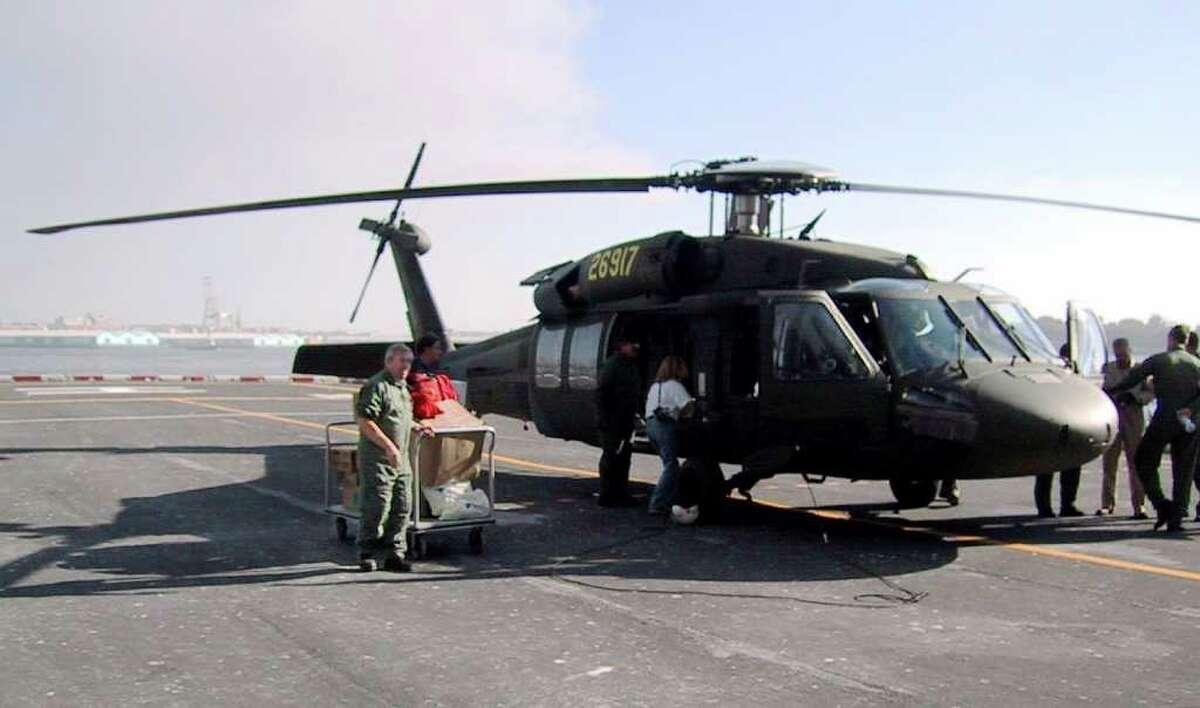Medical supplies being unloaded off a Black Hawk Helicopter at a heliport on the lower Eastside of Manhattan. The helicopter was flown out of Sikorsky Aircraft Corp. in Startford. with supplies and Doctors, one of them Dr. David Reed of New Canaan to assist at the World Trade Center tragedy.
