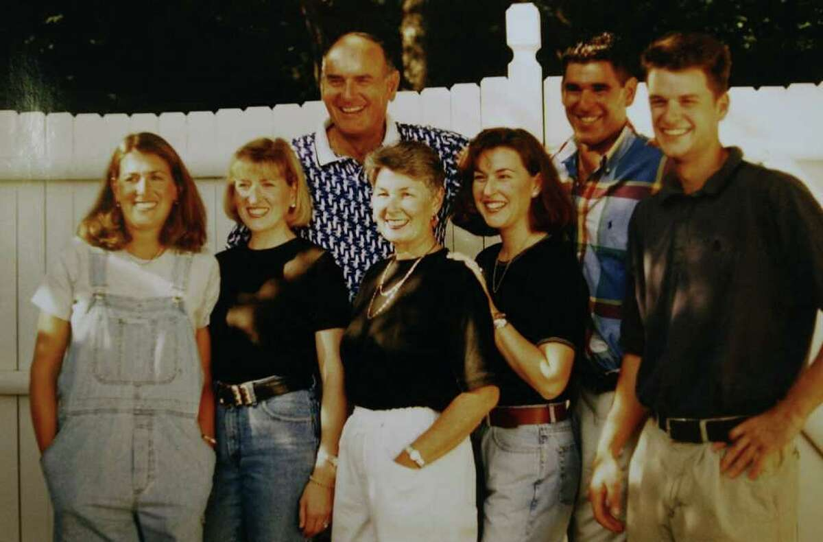 John Reo, far right, was killed in the Sept. 11, 2001 attack on the World Trade Center. This family photo also shows his sisters Suzanne, left, and Meghan; his mom, Judith; his dad, Armand, former superintendent of Troy schools; his sister Kristen and brother Mark. (Michael P. Farrell / Times Union archive)