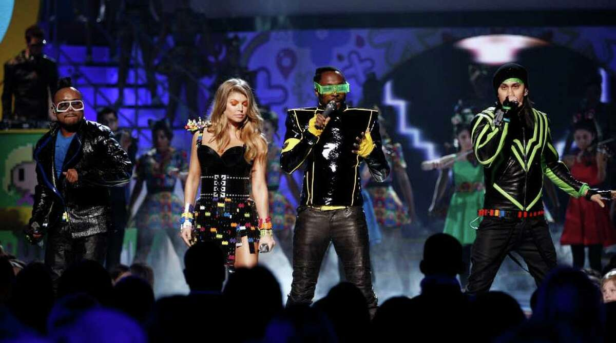 FILE - In this April 2, 2011 file photo, The Black Eyed Peas perform at Nickelodeon's 24th Annual Kids' Choice Awards in Los Angeles. The band will be performing a free concert in Central Park, June 9, 2011, to benefit the Robin Hood Foundation, in their mission to fight poverty. (AP Photo/Matt Sayles, file)