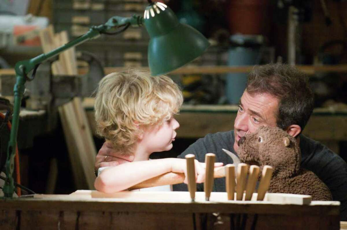 In this film publicity image released by Summit Entertainment, Riley Thomas Stewart, left, and Mel Gibson are shown in a scene from,