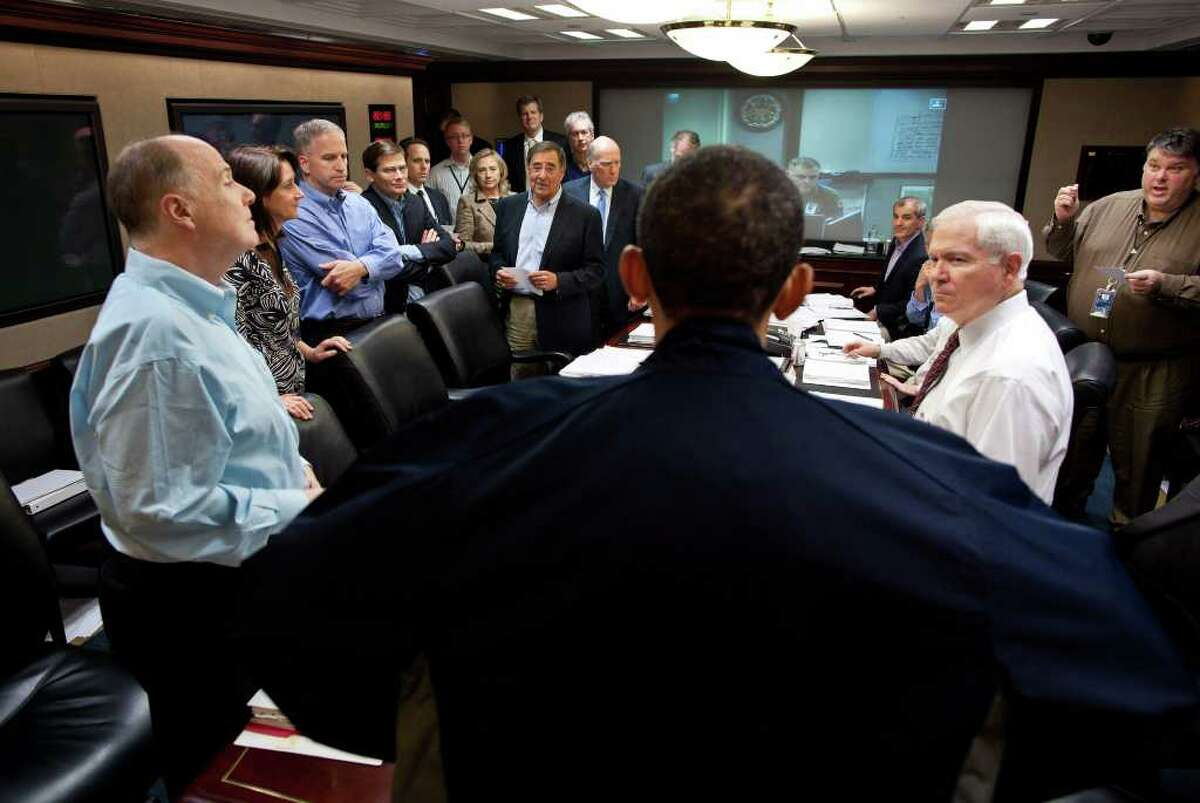 In this image released by the White House, President Barack Obama talks with members of the national security team at the conclusion of one in a series of meetings discussing the mission against Osama bin Laden, in the Situation Room of the White House, Sunday, May 1, 2011, in Washington.