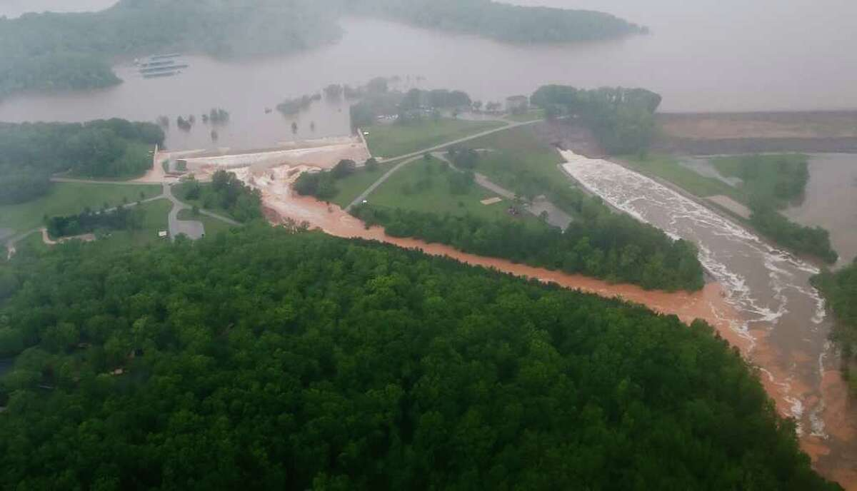 Floodwaters flow over Wappapello Lake's emergency spillway, left, on Monday, May 2, 2011. The normal spillway is at center right, and the dam is at far right. The Wayne County, Mo., lake sits on the St. Francis River, and the overflow threatens at least 1,000 people downstream. (AP Photo/Daily American Republic, Paul Davis)