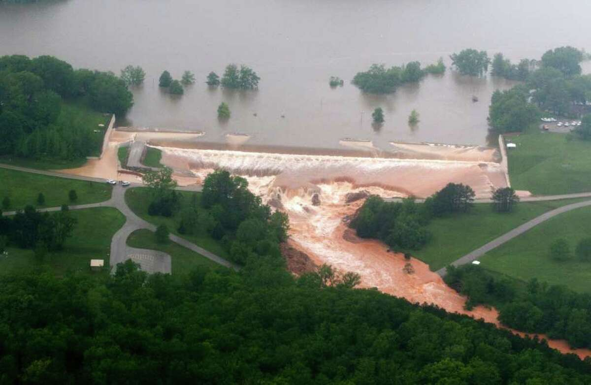 Water flows over the Wappapello Lake emergency spillway on the St. Francis River in Wayne County, Mo. on Monday, May 2, 2011. Several roads have been closed in southeast Missouri after heavy overnight rains pushed lakes and streams out of their banks. (AP Photo/Daily American Republic, Paul Davis)