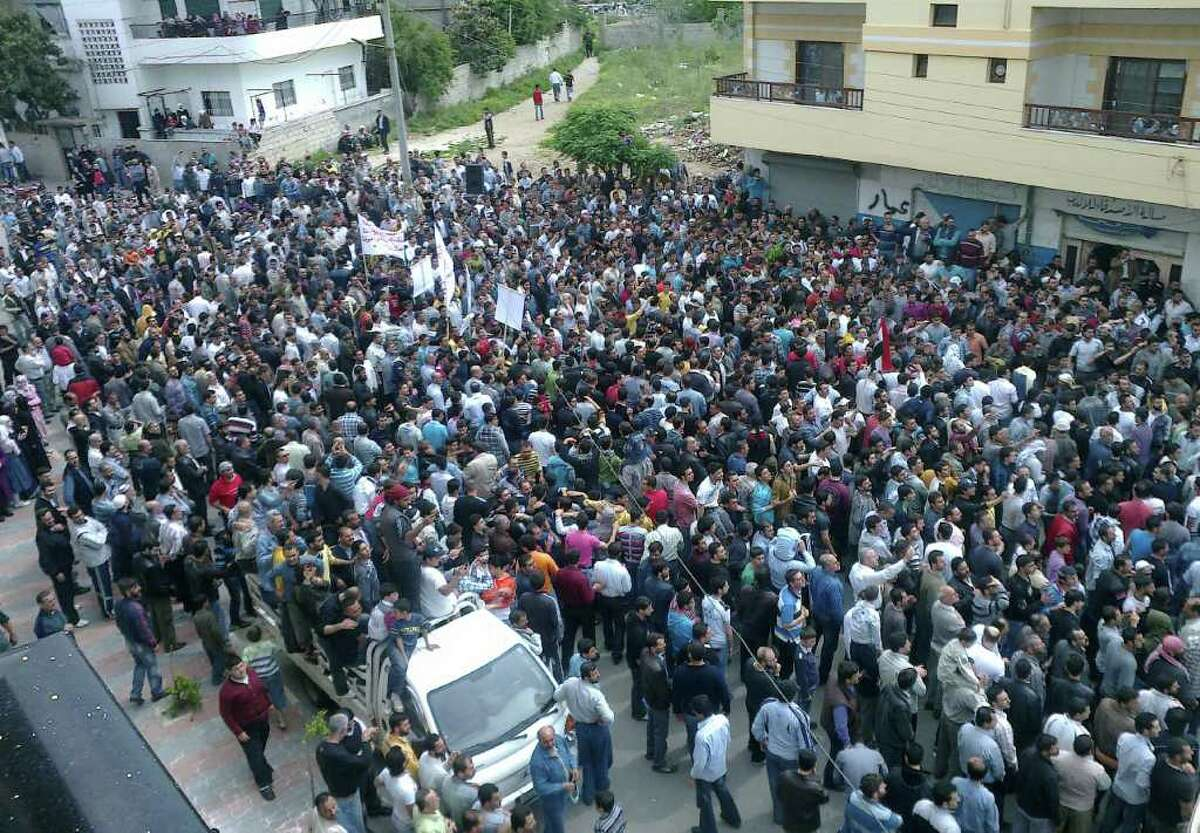 In this citizen journalism image taken on a mobile phone and acquired by the AP, Syrians gather after Friday prayers during an anti-government protest in the coastal city of Banias, Syria, Friday, April 29, 2011. Thousands of Syrian protesters chanting