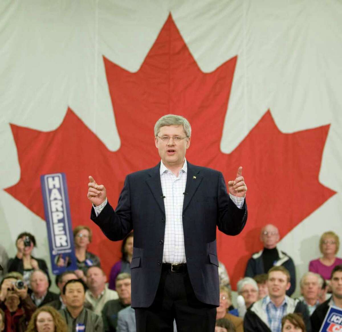 Prime Minister Stephen Harper speaks during a campaign rally in Stratford, Prince Edward Island, Canada near Charlottetown on Sunday May 1, 2011. Unexpected gains for the New Democratic Party have upended previous soundings that predicted the Conservatives would get enough votes to form a minority government, perhaps even a majority one. Now a new scenario has emerged in which the New Democrats and the Liberals together win enough seats to eventually form a coalition. (AP Photo/The Canadian Press, Adrian Wyld)