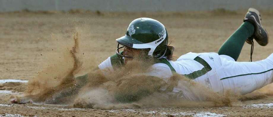 Southwest's Celeste Hernandez slides into home safely against Brandeis during the second inning Monday, May 2, 2011, at Southwest High School. Southwest won 8-4. Photo: EDWARD A. ORNELAS/EXPRESS-NEWS / SAN ANTONIO EXPRESS-NEWS (NFS)